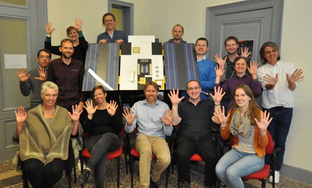 Photo of the PROBA2 team with a maquette of PROBA2
